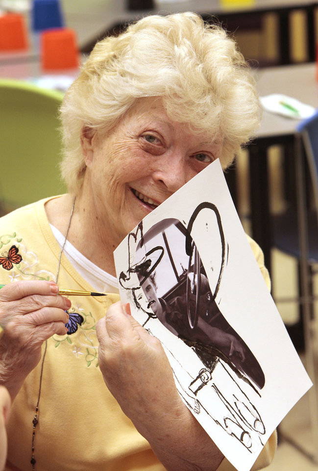 Photo - Dementia patient Peggy Morrison shows off her art project at the Oklahoma City Museum of Art. Photo by David McDaniel, The Oklahoman  David McDaniel - The Oklahoman