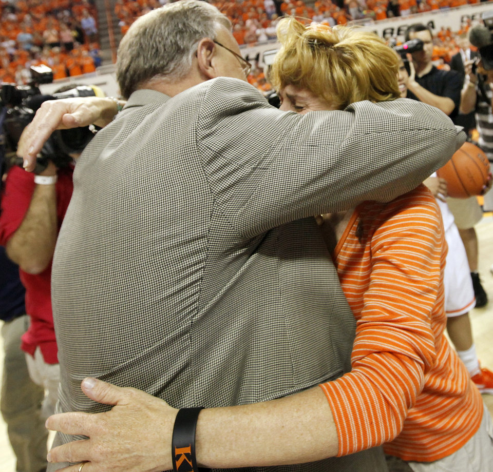 OSU head coach Jim Littell hugs Shelley Budke, widow of former OSU head coach Kurt Budke, after the Women's NIT championship college basketball game between Oklahoma State University and James Madison at Gallagher-Iba Arena in Stillwater, Okla., Saturday, March 31, 2012. Kurt Budke and three others were killed in a plane crash on a recruiting trip in November of 2011. OSU won, 75-68. Photo by Nate Billings, The Oklahoman
