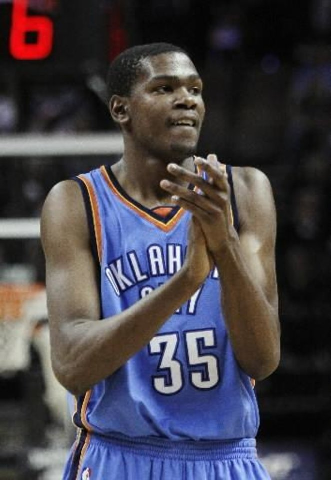 Photo - Oklahoma City Thunder forward  Kevin  Durant reacts during the fourth quarter of an NBA basketball game against the San Antonio Spurs in San Antonio, Tuesday, March 31, 2009. Oklahoma City won 96-95. (AP Photo/Eric Gay)