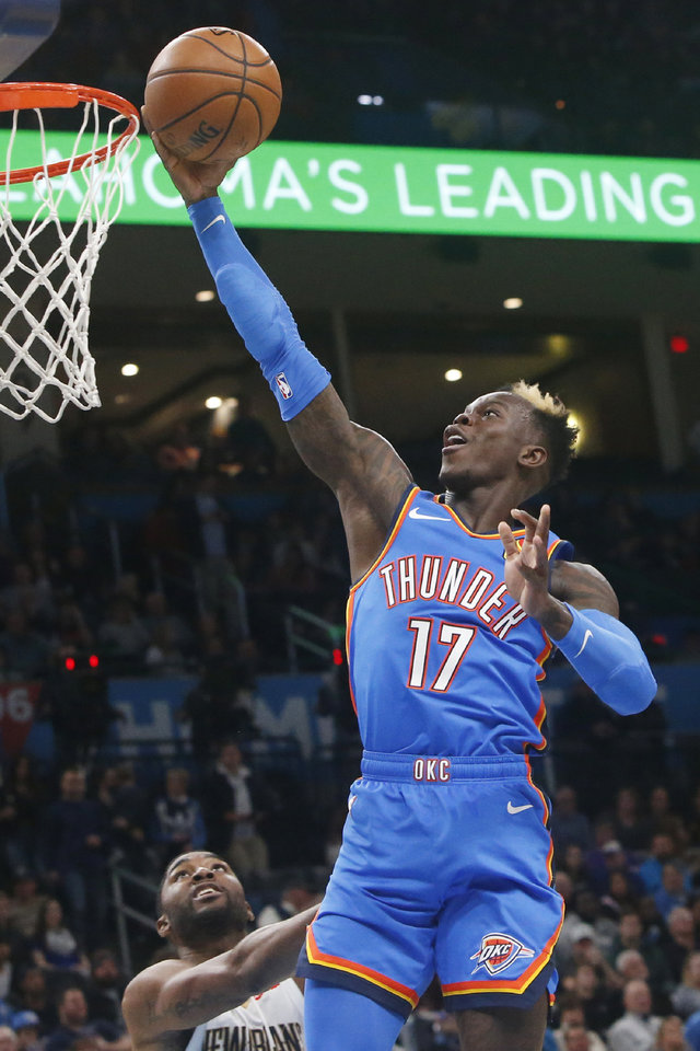 Photo - Oklahoma City Thunder guard Dennis Schroeder (17) goes to the basket in front of New Orleans Pelicans guard E'Twaun Moore during the first half of an NBA basketball game Friday, Nov. 29, 2019, in Oklahoma City. [AP Photo/Sue Ogrocki]