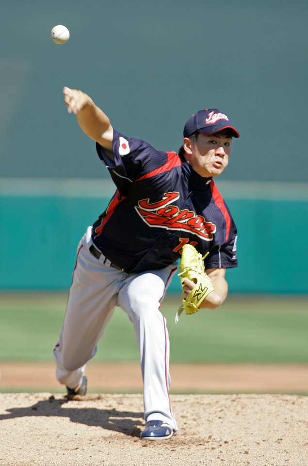 Photo - FILE - In this March 11, 2009, file photo, Japan's Masahiro Tanaka throws a warm up pitch before facing the San Francisco Giants in an exhibition baseball game in Scottsdale, Ariz. The New York Yankees and Tanaka agreed on Wednesday, Jan. 22, 2014, to a $155 million, seven-year contract. In addition to the deal with the pitcher, the Yankees must pay a $20 million fee to the Japanese team of the 25-year-old right-hander, the Rakuten Golden Eagles. (AP Photo/Jeff Chiu, File)
