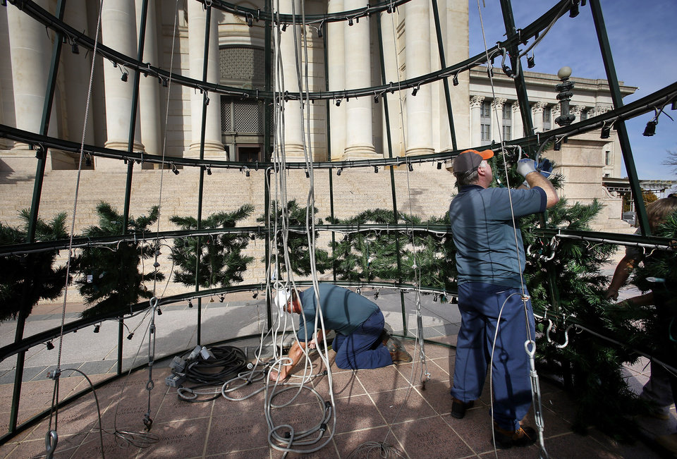 Workers began assembling the  Christmas tree on the south plaza of the state Capitol Monday afternoon, Nov. 19, 2012.  The 30-foot artificial pine tree has 256 branches and 2000 lights.  The tree was donated to the state by the Weyerhaeuser Company Foundation seven years ago.   Trustees from the Hillside Community Correctional Center assisted state employees in attaching the greenery and ornaments onto the frame. Photo by Jim Beckel, The Oklahoman