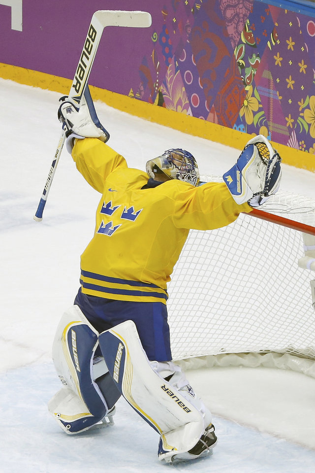 Photo - Sweden goaltender Henrik Lundqvist reacts to Swden's 2-1 victory over Findland in the men's semifinal ice hockey game at the 2014 Winter Olympics, Friday, Feb. 21, 2014, in Sochi, Russia. (AP Photo/Mark Humphrey)