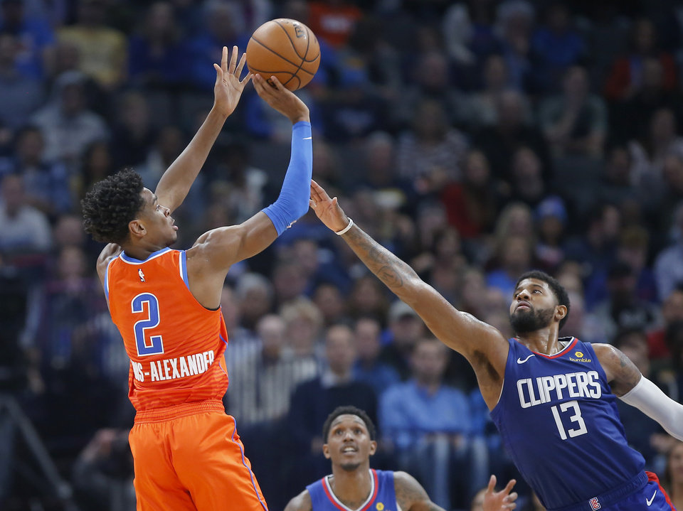 Photo - Oklahoma City's Shai Gilgeous-Alexander (2) shoots a basket over LA's Paul George (13) during an NBA basketball game between the Oklahoma City Thunder and the LA Clippers at Chesapeake Energy Arena in Oklahoma City, Sunday, Dec. 22, 2019. Oklahoma City won 118-112. [Bryan Terry/The Oklahoman]