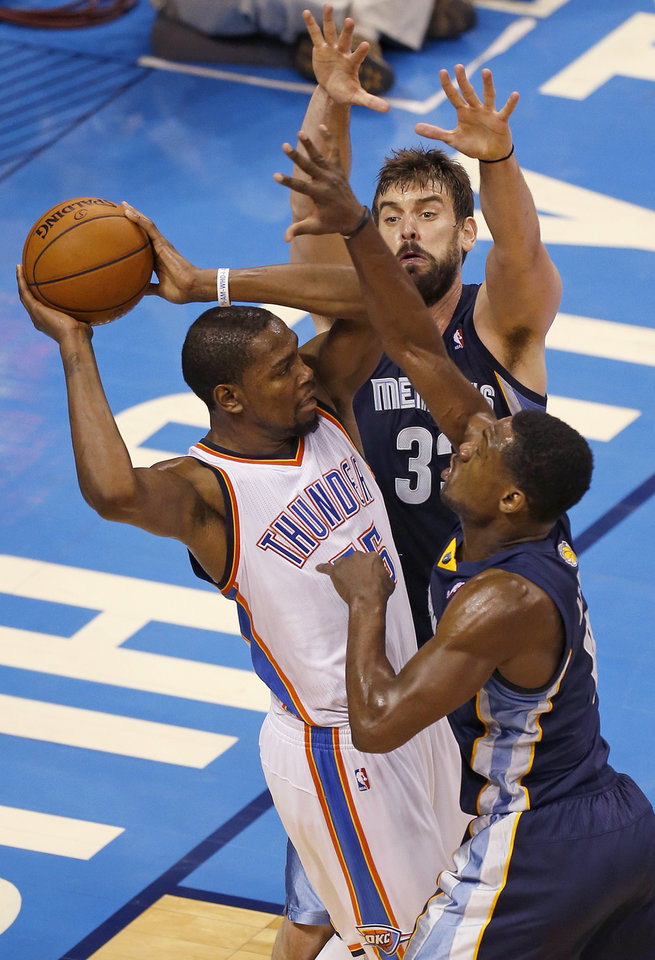 Photo - Oklahoma City's Kevin Durant (35) tries to pass as Memphis' Marc Gasol (33) and Tony Allen (9) defend during Game 1 in the first round of the NBA playoffs between the Oklahoma City Thunder and the Memphis Grizzlies at Chesapeake Energy Arena in Oklahoma City, Saturday, April 19, 2014. Photo by Nate Billings, The Oklahoman