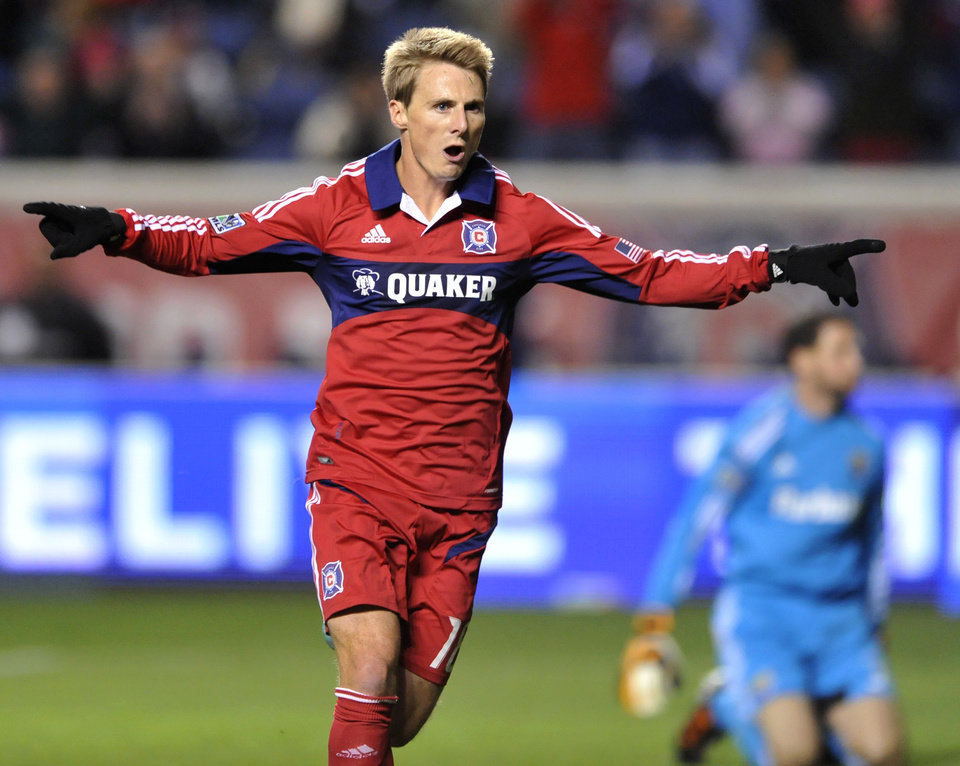 Photo -   Chicago Fire's Chris Rolfe celebrates after scoring a goal during the first half of an MLS soccer game against the Columbus Crew in Bridgeview, Ill., Saturday, Sept. 22, 2012. (AP Photo/Paul Beaty)