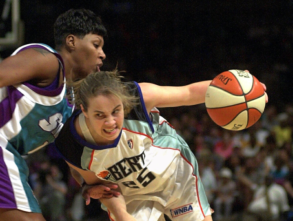 Photo - New York Liberty's Becky Hammon, right, drives past E.C. Hill of the Charlotte Sting during the second half Wednesday, July 12, 2000 at Madison Square Garden in New York. Hammon scored 16 points in the Liberty's 84-70 victory. (AP Photo/Ron Frehm)