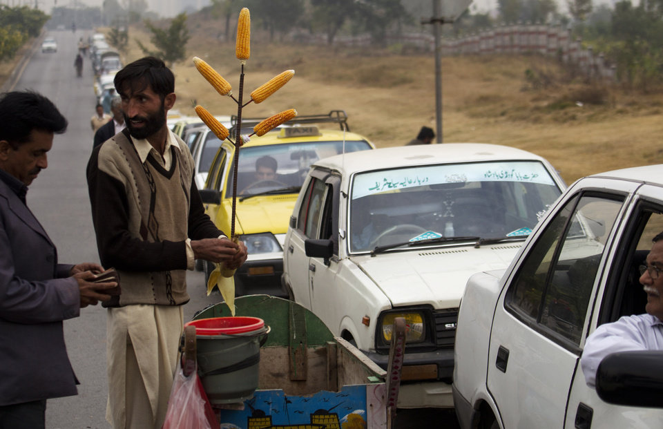 In this Wednesday, Dec. 5, 2012 photo, Drivers queue at a gas station in Islamabad, Pakistan. It has become a familiar site across Pakistan in recent weeks: Long lines of cars and minibuses snaking for hundreds of yards as their frustrated drivers wait to fill up their tanks with natural gas. (AP Photo/B.K. Bangash)
