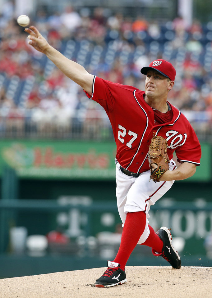 Photo - Washington Nationals starting pitcher Jordan Zimmermann throws during the first inning of a baseball game against the Philadelphia Phillies at Nationals Park, Saturday, Aug. 2, 2014, in Washington. (AP Photo/Alex Brandon)