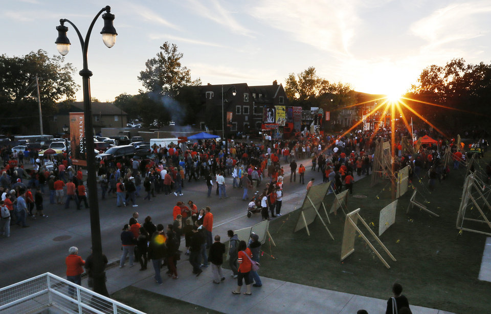 University Ave. fills with OSU students, alumni and visitors as the sun sets during Walkaround at Oklahoma State University's homecoming in Stillwater, Okla., Friday, Oct. 19, 2012. Photo by Nate Billings, The Oklahoman