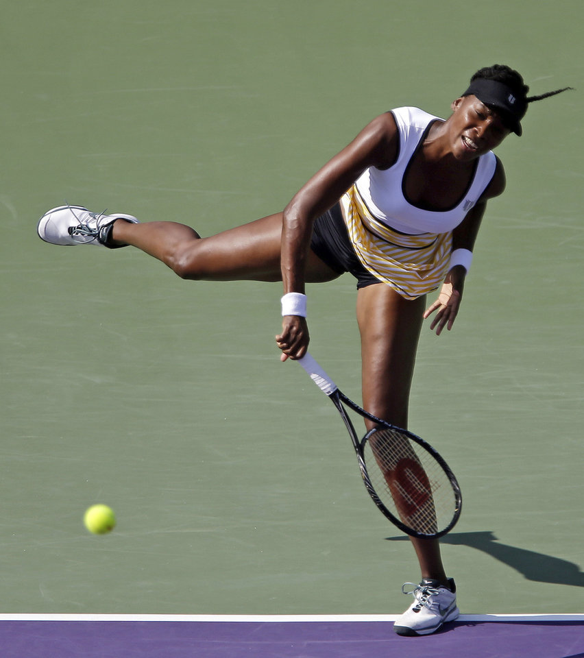 Photo - Venus Williams, of the United Staes, serves to Casey Dellacqua, of Australia, at the Sony Open tennis tournament in Key Biscayne, Fla., Sunday, March 23, 2014. (AP Photo/Alan Diaz)