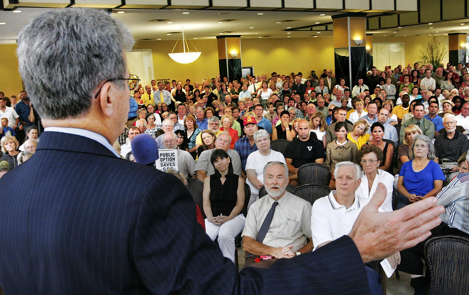 Photo - SENATOR / FORUM / PROPOSED HEALTH CARE REFORM / BILL / PROPOSAL: The lobby of Chase Bank in downtown Oklahoma City was crammed with more than 500 people who came to hear U.S. Sen. Tom Coburn at a town hall meeting Monday afternoon, Aug. 24, 2009.  Photo by Jim Beckel, The Oklahoman ORG XMIT: KOD