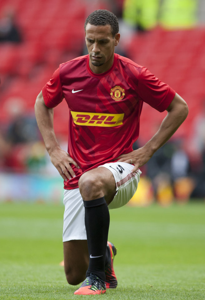 Photo -   Manchester United's Rio Ferdinand warms up before their English Premier League soccer match against Stoke at Old Trafford Stadium, Manchester, England, Saturday, Oct. 20, 2012. (AP Photo/Jon Super)
