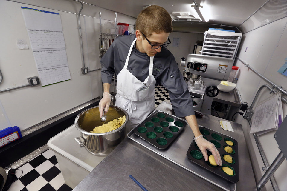 Photo - In this June 19, 2014 photo, chef Alex Tretter prepares cannabis-infused peanut butter and jelly cups before baking them, at Sweet Grass Kitchen, a well-established gourmet marijuana edibles bakery which sells its confections to retail outlets, in Denver. Sweet Grass Kitchen, like other cannabis food producers in the state, is held to rigorous health inspection standards, and has received praise from inspectors, according to owner Julie Berliner. (AP Photo/Brennan Linsley)