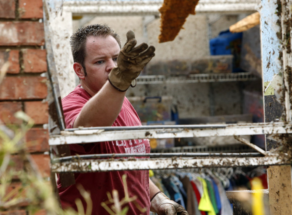 Ben Donihoo throws debris from inside his roofless home after a tornado near SW 149th and Western on Monday, May 20, 2013  in Moore, Okla. Photo by Steve Sisney, The Oklahoman