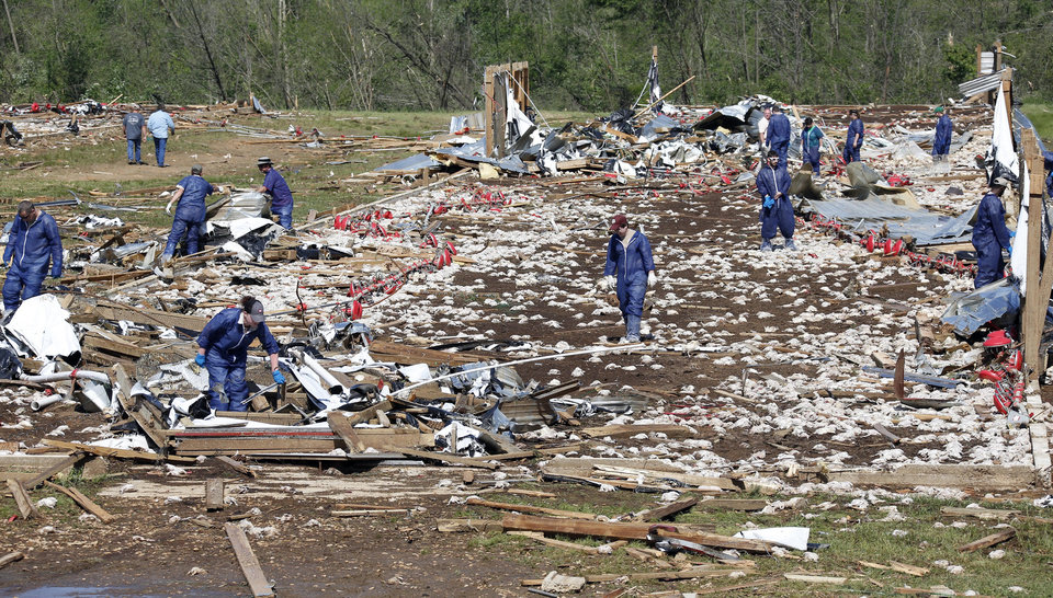 Photo - Tyson Foods workers continue tornado cleanup at Wilkes Farm, an 8-chicken house operation that was leveled in Noxapater, Miss., Wednesday, April 30, 2014. The farm raises broilers for Tyson and each house has 28,500 chickens. Several poultry raising farms near Louisville were damaged or destroyed by tornadoes Monday. (AP Photo/Rogelio V. Solis)