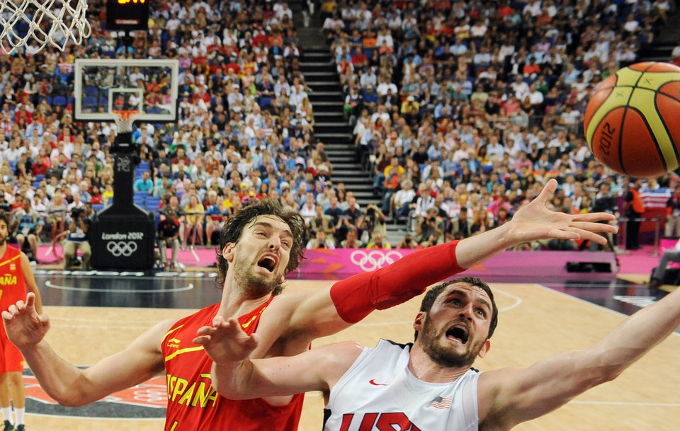 United States' Kevin Love, right, vies for the ball with Spain's Pau Gasol, left, during the men's gold medal basketball game at the 2012 Summer Olympics  in London on Sunday, Aug. 12, 2012. (AP Photo/Mark Ralston, Pool)