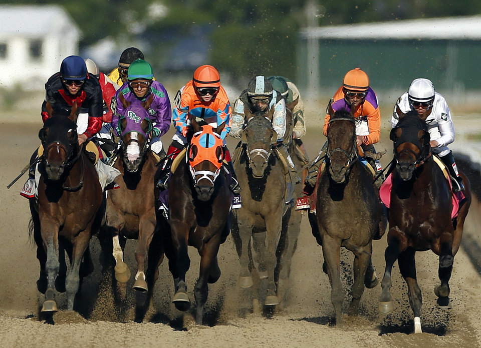 Photo - California Chrome, second from left,, runs in traffic behind Tonalist, left, and General A Rod (10) and as they head down the backstretch during the 146th running of the Belmont Stakes horse race at Belmont Park, Saturday, June 7, 2014, in Elmont, N.Y.  Tonalist went on to win the race, denying California Chrome the Triple Crown victory. (AP Photo/Jason DeCrow)