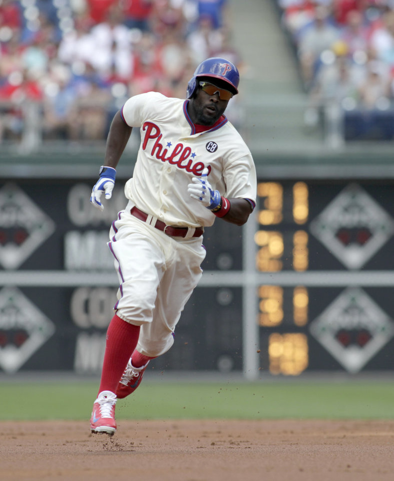 Photo - Philadelphia Phillies' Tony Gwynn runs to third for a triple against the Atlanta Braves in the first inning of the first game of a baseball double-header Saturday, June 28, 2014, in Philadelphia.  (AP Photo/H. Rumph Jr)