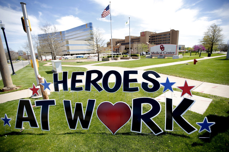 Photo - A sign for medical workers is placed in front of the OU Medical Center in Oklahoma City,  Saturday, March 28, 2020.  [Sarah Phipps/The Oklahoman]