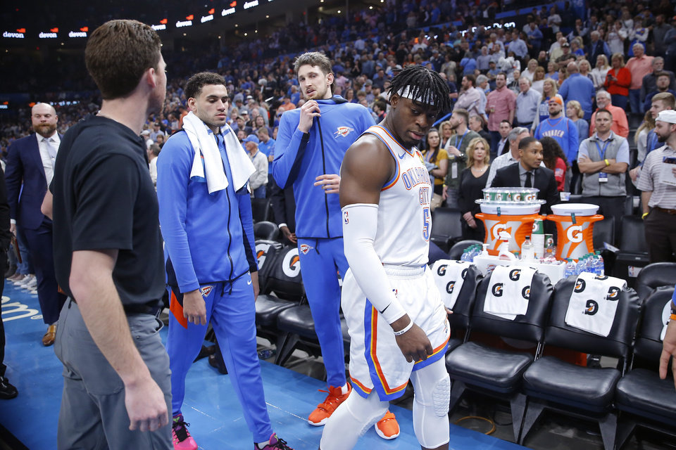 Photo - Luguentz Dort (5), Mike Muscala and Abdel Nader (11), at left, leave the court before an NBA basketball game between the Oklahoma City Thunder and the Utah Jazz was postponed at Chesapeake Energy Arena in Oklahoma City, Wednesday, March 11, 2020. [Bryan Terry/The Oklahoman]