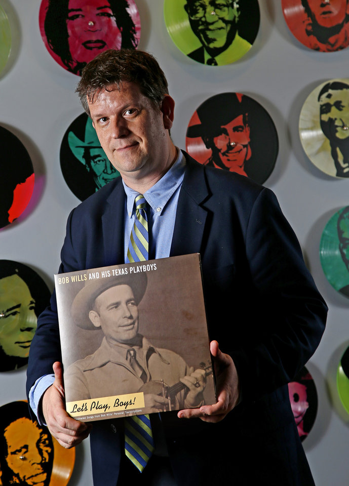 Photo - Project Director for the OKPOP Museum Jeff Moore holds a copy of a new Bob Wills record,