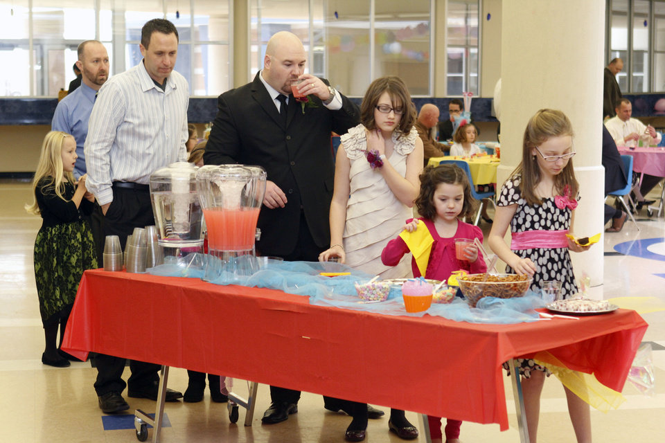 Fathers and daughters pick up party snacks during the Deer Creek Daddy daughter dance at Deer Creek High School in Oklahoma City, OK, Saturday, January 26, 2013,  By Paul Hellstern, The Oklahoman