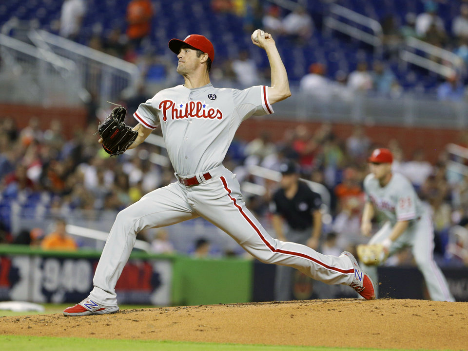 Photo - Philadelphia Phillies' Cole Hamels delivers a pitch during the first inning of a baseball game against the Miami Marlins, Wednesday, July 2, 2014 in Miami. (AP Photo/Wilfredo Lee)