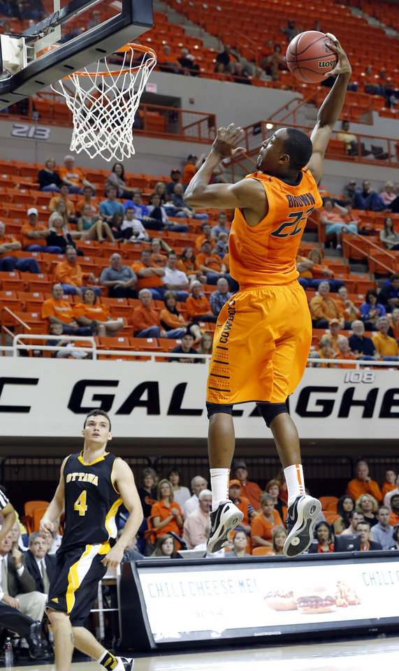 Oklahoma State's Markel Brown dunks during the college basketball game between Oklahoma State University and Ottawa (Kan.) at Gallagher-Iba Arena in Stillwater, Okla., Thursday, Nov. 1, 2012. Photo by Sarah Phipps, The Oklahoman