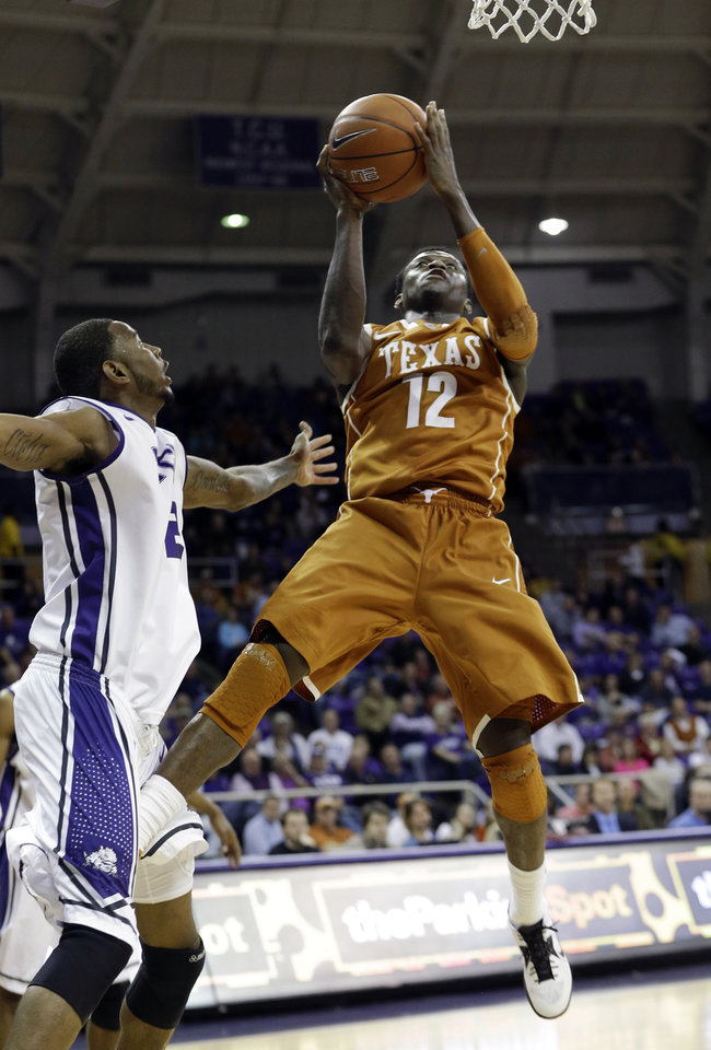 Photo - Texas guard Myck Kabongo (12) shoots against TCU forward Connell Crossland  during the first half of an NCAA college basketball game Tuesday, Feb. 19, 2013, in Fort Worth, Texas. (AP Photo/LM Otero)