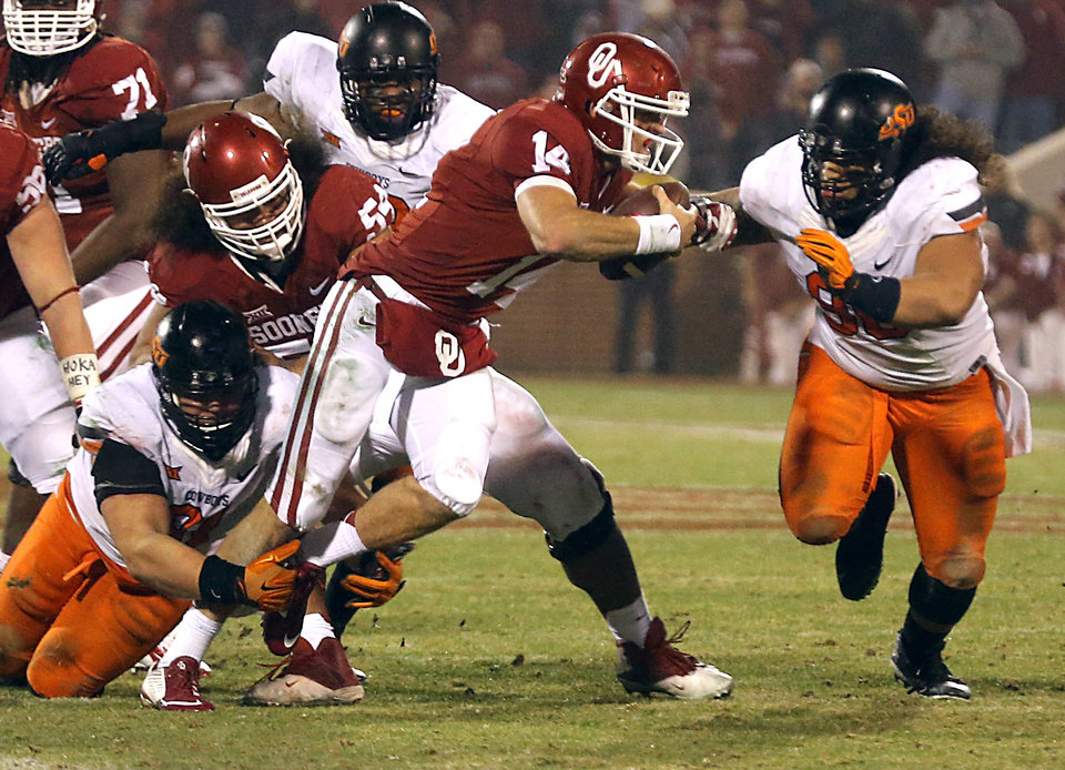 Photo - Oklahoma State's James Castleman (91) and Ofa Hautau (98) sack Oklahoma's Cody Thomas (14) during a Bedlam college football game between the University of Oklahoma Sooners (OU) and the Oklahoma State University Cowboys (OSU) at the Gaylord Family Oklahoma Memorial Stadium in Norman, Okla. on Saturday, Dec. 6, 2014. Photo by Chris Landsberger, The Oklahoman