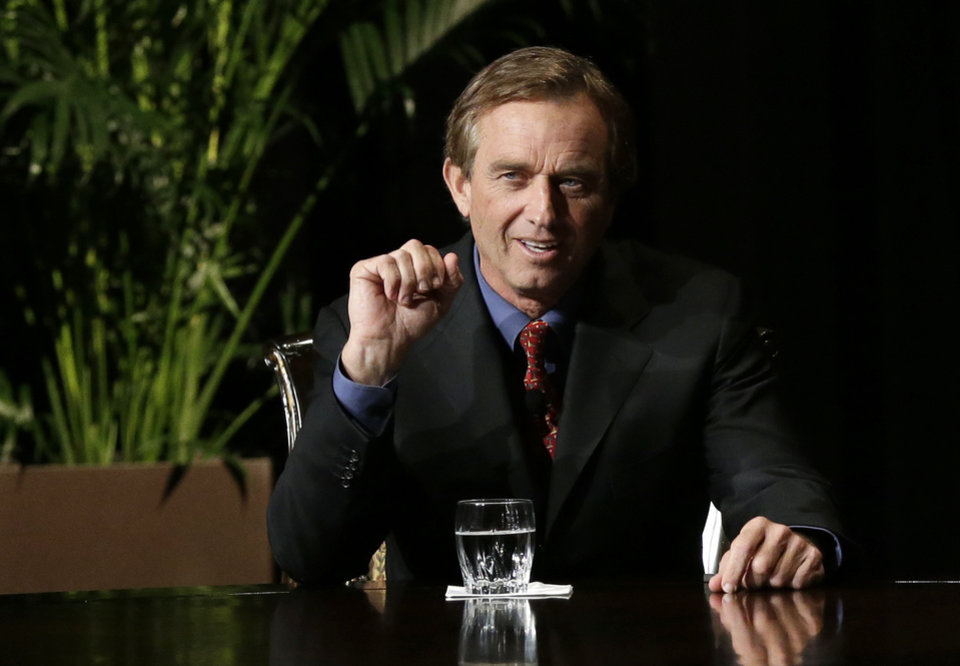Robert F. Kennedy Jr., left, makes comments during the opening minutes of a interview with journalist Charlie Rose in front of a full audience at the AT&T Performing Arts Center Friday, Jan. 11, 2013, in Dallas, Texas. The Kennedys are in Dallas as a year of observances begins for the 50th anniversary of President John F. Kennedy\'s assassination. (AP Photo/Tony Gutierrez)