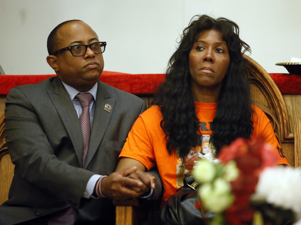 Photo - Bishop Tavis Grant holds the hand of Alice Williams, mother of Darnell Williams, during a rally in support of Darrell Williams at Mt. Zion Baptist Church in Stillwater, Okla., Thursday, Aug. 23, 2012. Williams, a suspended Oklahoma State basketball player, was found guilty on two counts of rape by instrumentation and one count of sexual battery after an incident at a house party. Photo by Nate Billings, The Oklahoman