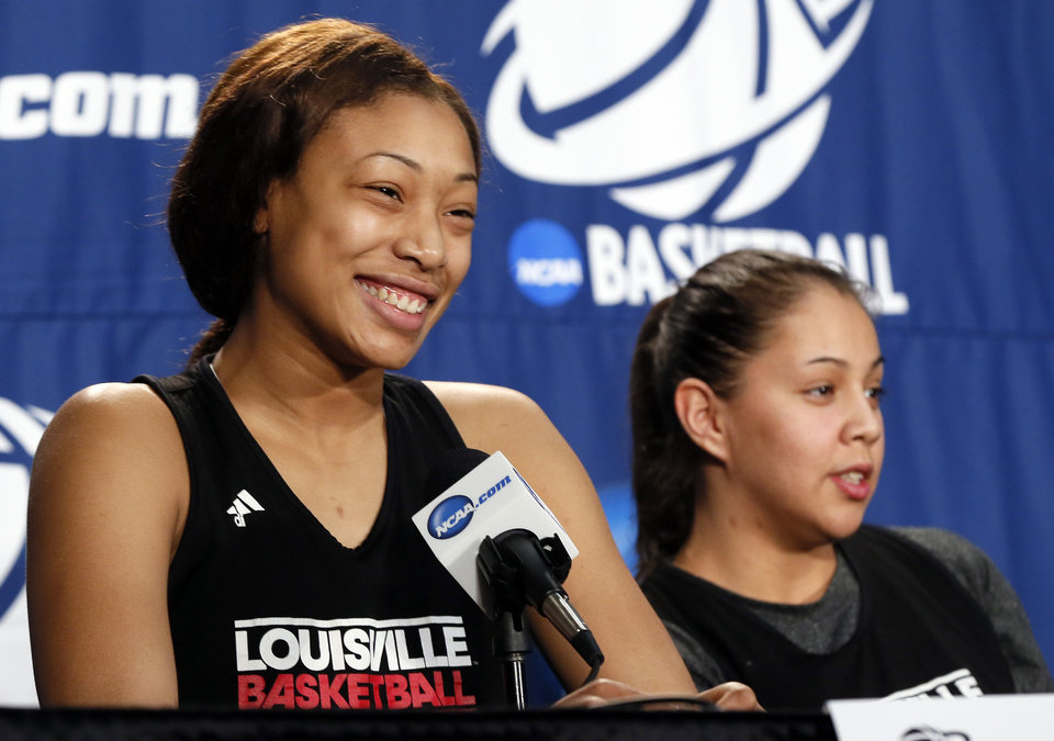 Photo - Louisville's Antonita Slaughter (4), left, smiles next to Shoni Schimmel (23) during the press conference and practice day at the Oklahoma City Regional for the NCAA women's college basketball tournament at Chesapeake Energy Arena in Oklahoma City, Saturday, March 30, 2013. Photo by Nate Billings, The Oklahoman