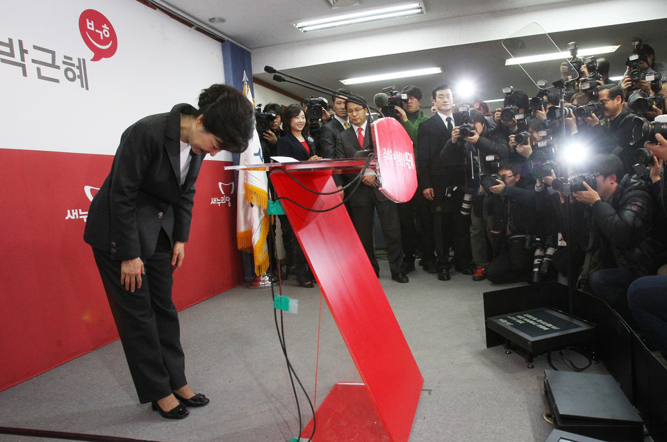 South Korea's president-elected Park Geun-hye bows to the nation during a press conference at the headquarters of Saenuri Party in Seoul, South Korea, Thursday, Dec. 20, 2012. Park was elected South Korean president Wednesday, becoming the country's first female leader despite the incumbent's unpopularity and her own past as the daughter of a divisive dictator. (AP Photo/Ahn Young-joon)