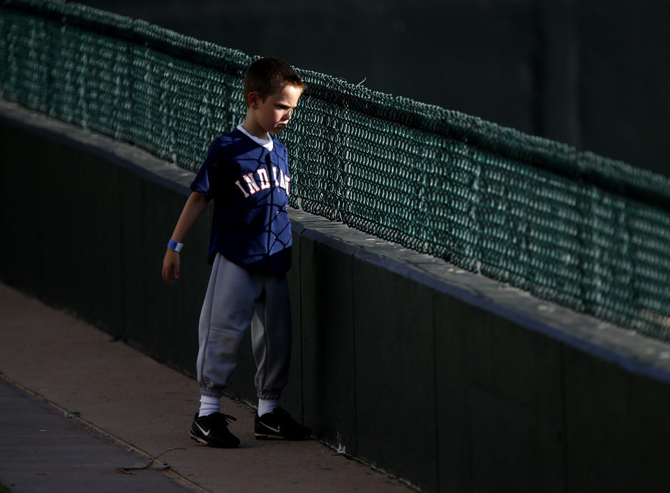 Cale Heath, 7, of Oklahoma City watches the Colorado Springs pitchers in the bullpen during an Oklahoma City RedHawks game at Chickasaw Bricktown Ballpark in Oklahoma City, Tuesday, August 6, 2013. Photo by Bryan Terry