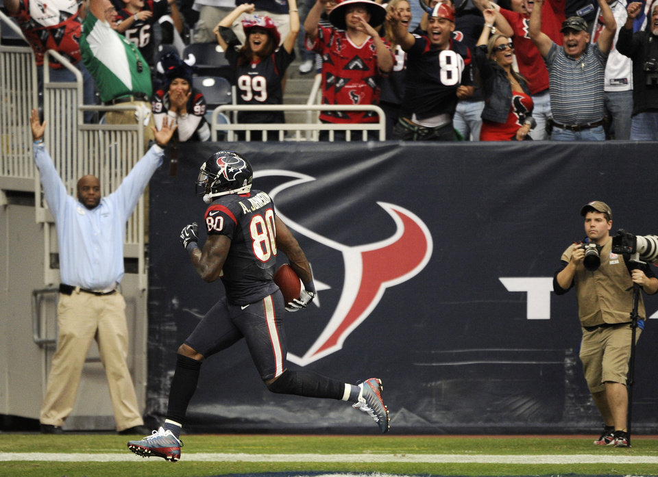 Photo -   Houston Texans wide receiver Andre Johnson scores the winning touchdown against the Jacksonville Jaguars in overtime of an NFL football game Sunday, Nov. 18, 2012, in Houston. The Texans won 43-37. (AP Photo/Dave Einsel)