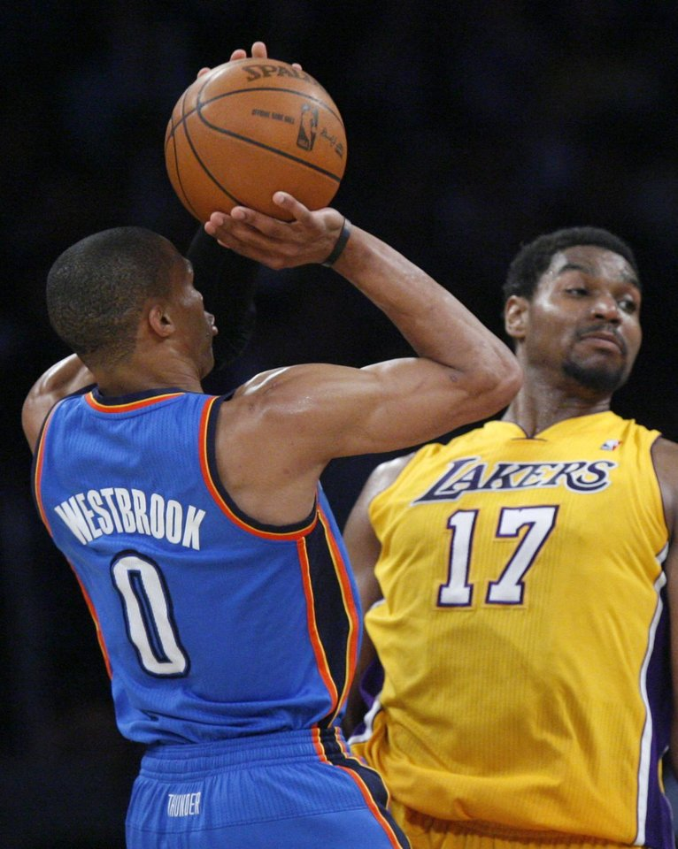 Oklahoma City\'s Russell Westbrook (0) shoots over Los Angeles\' Andrew Bynum (17) during Game 4 in the second round of the NBA basketball playoffs between the L.A. Lakers and the Oklahoma City Thunder at the Staples Center in Los Angeles, Saturday, May 19, 2012. Photo by Nate Billings, The Oklahoman