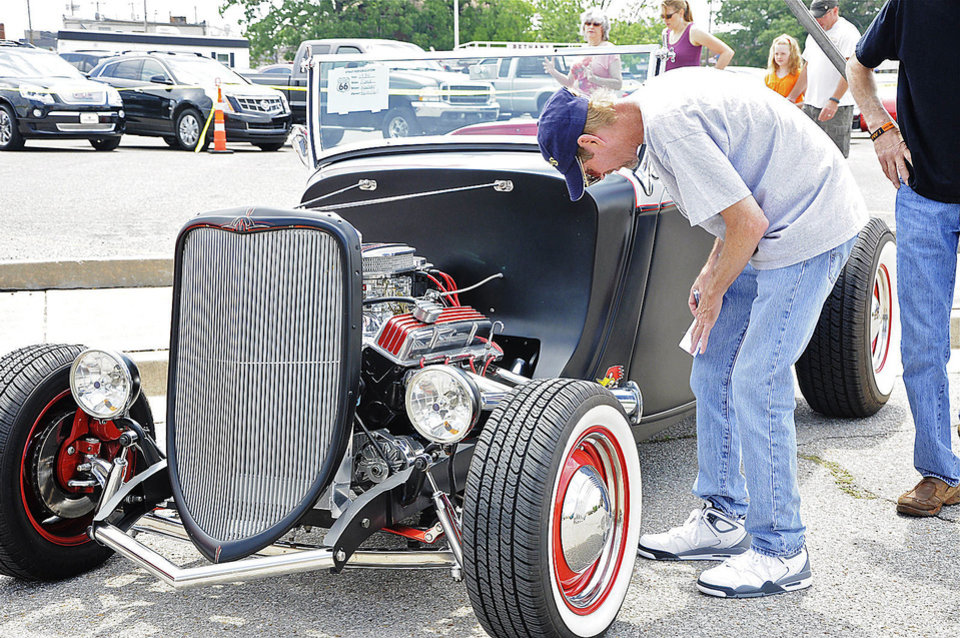 Photo -  David Kamp casts his vote in the car show competition during the Bethany 66 Festival on Saturday. PHOTO BY M. TIM BLAKE, FOR THE OKLAHOMAN