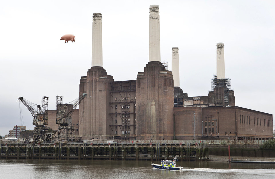FILE This Monday, Sept. 26, 2011 file photo shows a police boaton the Thames river below an inflatable pink pig, which was made famous on the sleeve of the 1976 Pink Floyd album 'Animals', and flies once again over Battersea Power Station in south west London. Chelsea said Friday May 4, 2012 it has submitted an offer to buy land to potentially build a new stadium in west London. The Premier League club has developed plans to build a 60,000-seat stadium on the site of derelict Battersea Power Station, whose four chimneys and wash towers are a London landmark. Chelsea's current 41,800-capacity Stamford Bridge is only the eighth largest in the Premier League. (AP Photo/Joel Ryan)