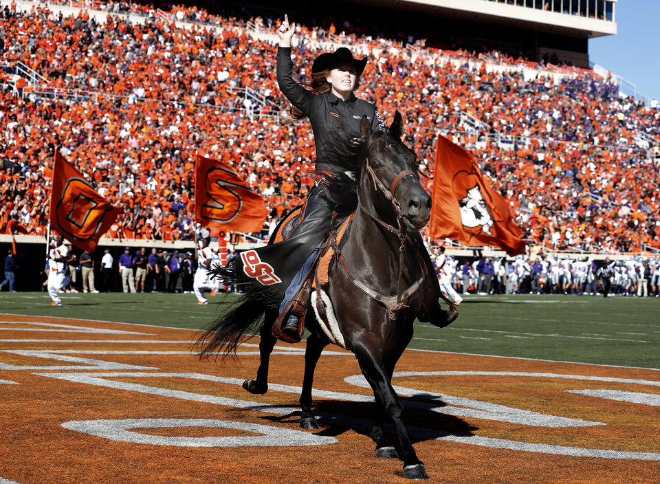 Bullets gallops on the field after a score during the first half of a college football game between the Oklahoma State University Cowboys (OSU) and the Kansas State University Wildcats (KSU) at Boone Pickens Stadium in Stillwater, Okla., Saturday, Oct. 5, 2013. OSU won 33-29.Photo by Sarah Phipps, The Oklahoman