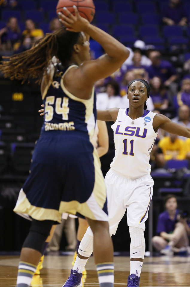 Photo - In a March 23, 2014 photograph, LSU guard Raigyne Moncrief (11) guards Georgia Tech forward Roddreka Rogers (54) prior to injuring her left knee in the second half of an NCAA college basketball first-round tournament game against Georgia Tech in Baton Rouge, La. LSU officials said Moncrief was to be examined by doctors Monday and her playing status would be determined prior to the start of the second round game Tuesday night. (AP Photo/Rogelio V. Solis)