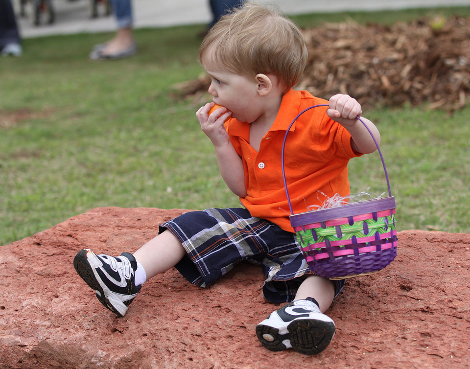 CHILD / CHILDREN / KIDS: Brandon Wilson, 1, of Midwest City, plays with his findings after an Easter egg hunt during Hopabaloo at the Oklahoma City Zoo, Sunday, April 8, 2012.  Photo by Garett Fisbeck, For The Oklahoman