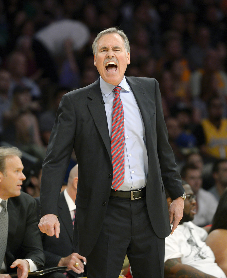 Photo - FILE - In this Feb. 21, 2014, file photo, Los Angeles Lakers head coach Mike D'Antoni yells at referees during the second half of an NBA basketball game against the Boston Celtics in Los Angeles. D'Antoni has resigned after less than two seasons on the job. Lakers spokesman John Black confirmed D'Antoni's resignation Wednesday, April 30. (AP Photo/Mark J. Terrill, File)