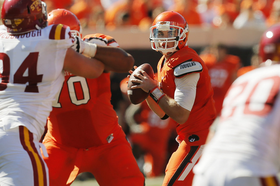 Photo - Oklahoma State's J.W. Walsh (4) looks to pass during a college football game between Oklahoma State University (OSU) and Iowa State University (ISU) at Boone Pickens Stadium in Stillwater, Okla., Saturday, Oct. 20, 2012. OSU won, 31-10. Photo by Nate Billings, The Oklahoman