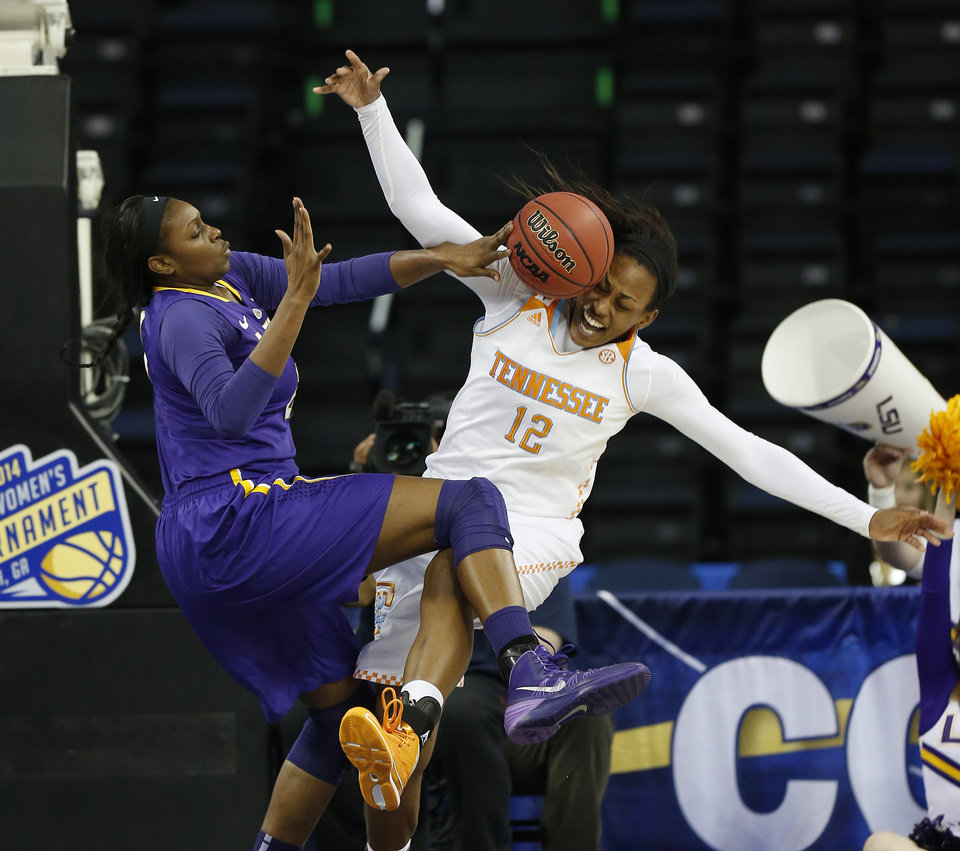 Photo - LSU forward Shanece McKinney (21) blocks Tennessee forward Bashaara Graves' shot during the first half in an NCAA college basketball game in the quarterfinals of the Southeastern Conference women's tournament, Friday, March 7, 2014, in Duluth, Ga. (AP Photo/John Bazemore)
