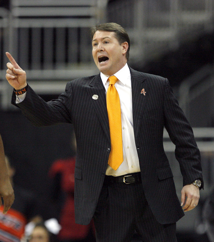 Oklahoma State head coach Travis Ford argues a call during the Big 12 tournament men's basketball game between the Oklahoma State Cowboys and Missouri Tigers the Sprint Center, Thursday, March 8, 2012. Photo by Sarah Phipps, The Oklahoman