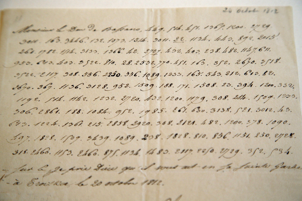"In this photo taken Wednesday, Nov. 28, 2012, a letter dictated by Napoleon in secret code that declares his intentions ""to blow up the Kremlin"" during his ill-fated Russian campaign is displayed in Fontainebleau, outside Paris. The rare letter, written in unusually emotive language, sees Napoleon complain of harsh conditions and the shortcomings of his grand army. The letter goes on auction Sunday, Dec. 2, 2012. (AP Photo/Christophe Ena)"