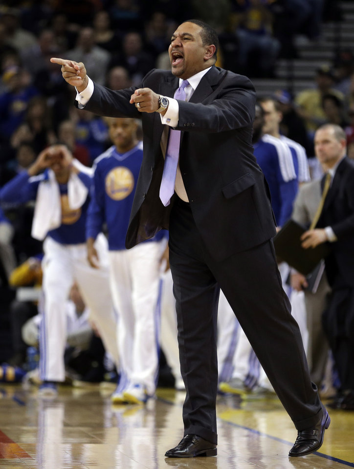 Golden State Warriors coach Mark Jackson gestures from the sideline in the first half of an NBA basketball game against the Phoenix Suns Saturday, Feb. 2, 2013, in Oakland, Calif. (AP Photo/Ben Margot)