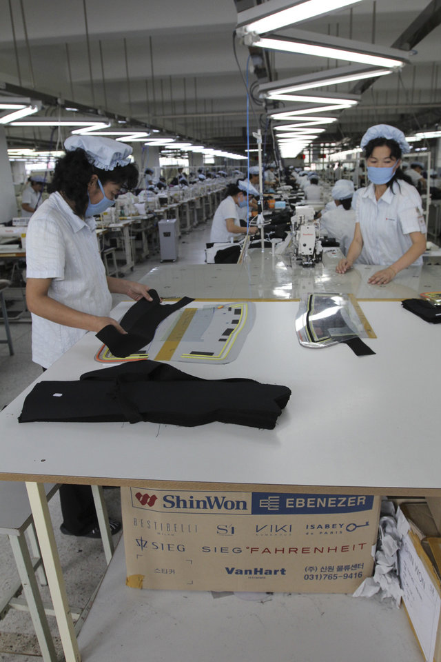 In this Sept. 21, 2012 photo, North Korean workers prepare garments for production at the South Korean-run ShinWon Corp. factory inside the Kaesong industrial complex in Kaesong, North Korea. On Wednesday, April 3, 2013, North Korea refused entry to South Koreans trying to cross the Demilitarized Zone to get to their jobs managing factories in the North Korean city of Kaesong. Pyongyang had threatened in recent days to close the border in anger over South Korea's support of U.N. sanctions punishing North Korea for conducting a nuclear test in February. (AP Photo/Jean H. Lee)